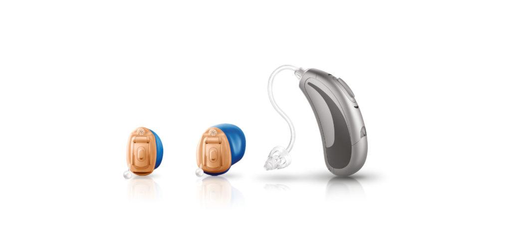 zwei kleine Im-Ohr-Hörsysteme und ein jamHD Hörsysteme in Silber