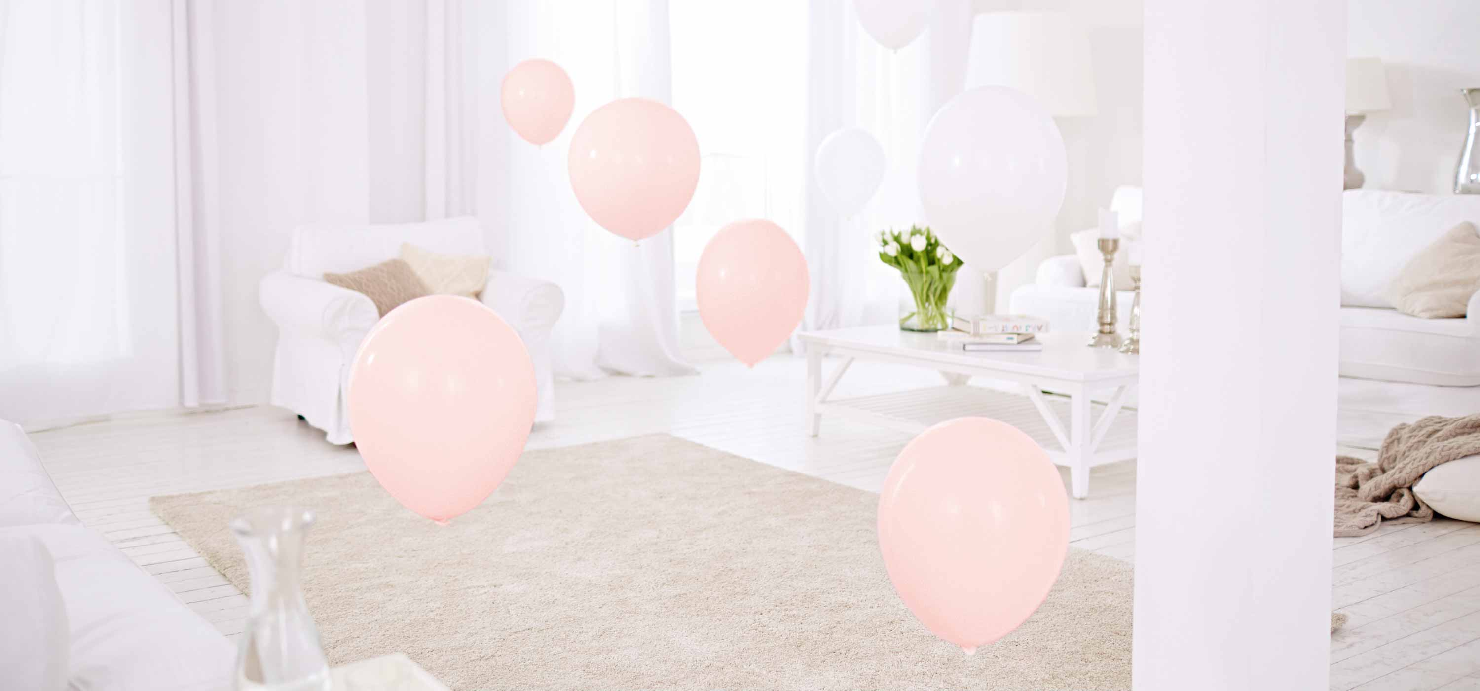 Balloons fly through a room to symbolize the new ease of hearing.